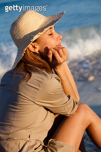 woman siiting on the beach