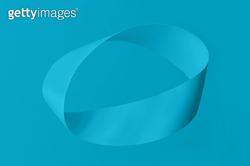Mobius strip soaring in the air on blue mint background