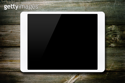 (Clipping path) Blank digital tablet on wood background