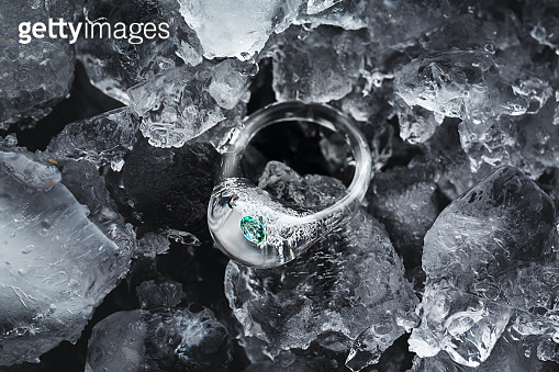Transparent icy rings made from glass in ice and water