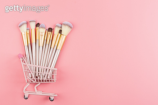 Cosmetic Makeup brushes on pink background. Flat lay, top view, copy space. Makeup accessories, mockup, template