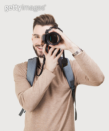 Young men photographer with dslr camera