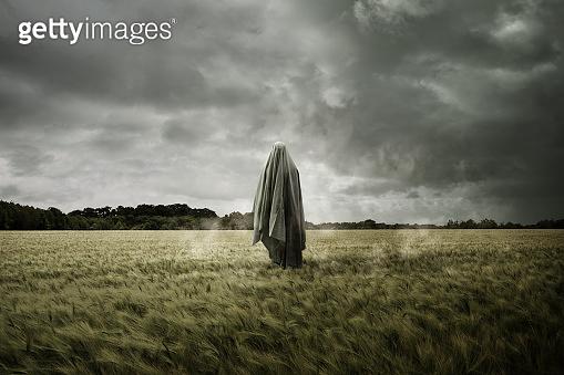 Haunted Spirit Ghost Floating Through a Bleak Landscape