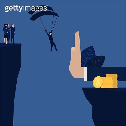 Businessman landing to coins stack but stopped by hand metaphor of profit and loss.