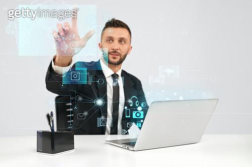 Businessman using virtual 3D projection.