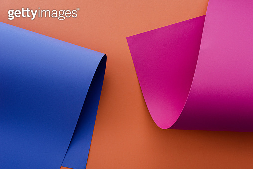 blue and pink colorful paper on orange background