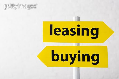 directional arrows with leasing and buying lettering isolated on white