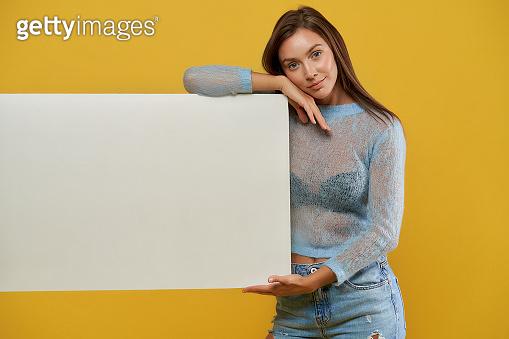 Beautiful girl holding white mock up placard