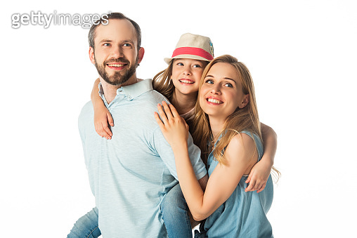 happy smiling family embracing isolated on white