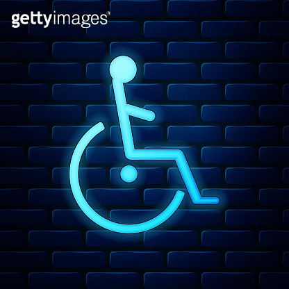 Glowing neon Disabled handicap icon isolated on brick wall background. Wheelchair handicap sign. Vector Illustration