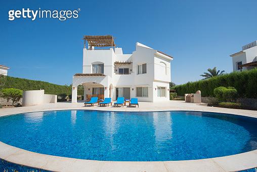 Swimming pool at a luxury tropical holiday villa resort