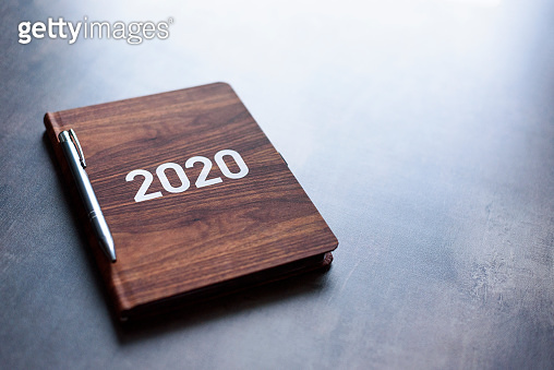 Personal book calendar with 2020 year on cover. Wooden pattern.