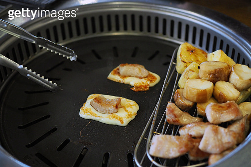 Grilled cheese with Korean grill pork belly BBQ (Samgyeopsal Gui) - trendy Korean barbecue dish, served with fresh vegetable and dipping sauce