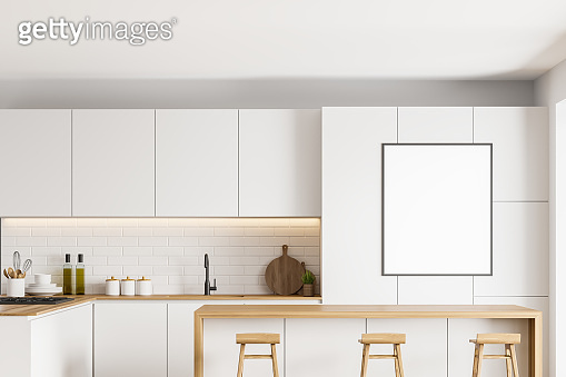 White kitchen interior with bar and poster