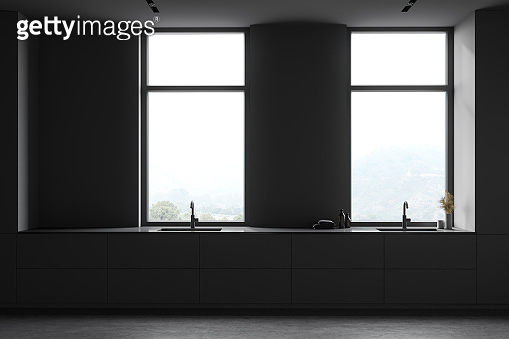 Double sink in grey bathroom with windows
