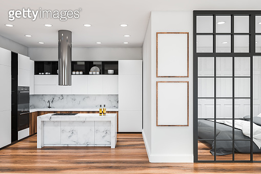 White and black kitchen with posters and bedroom
