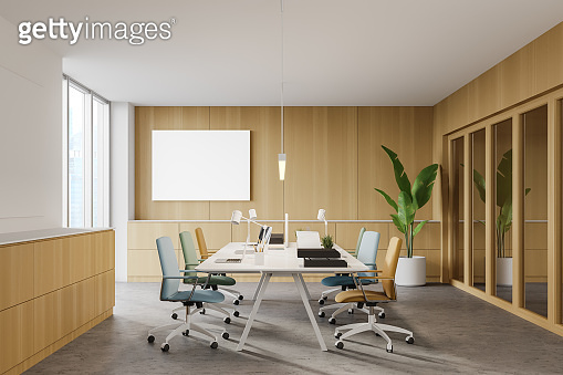 Wooden office, colorful chairs and poster