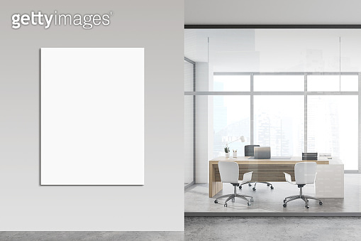 White and glass CEO office with poster