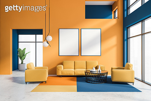 Orange and blue living room with poster gallery