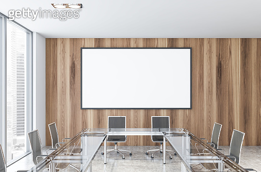 Wooden wall conference room with poster