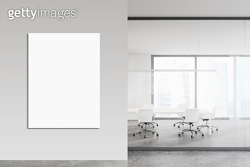 White conference room with vertical poster