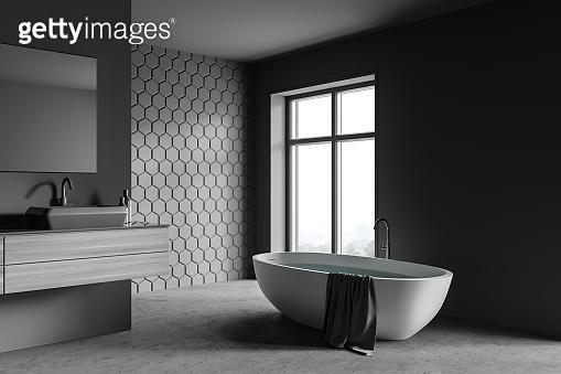 Grey honeycomb tile bathroom, tub and sink