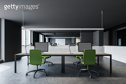 Gray open space office with green chairs