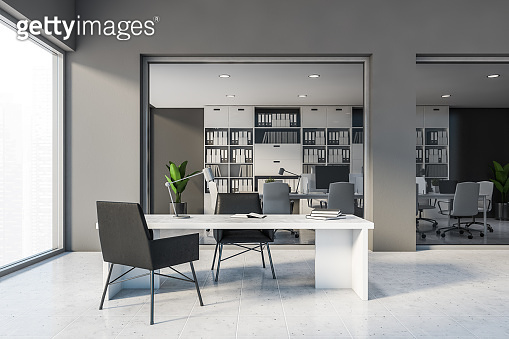 Grey CEO office interior with black chairs