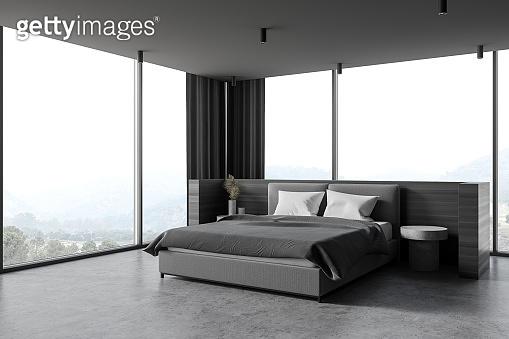 Modern wooden and gray master bedroom corner