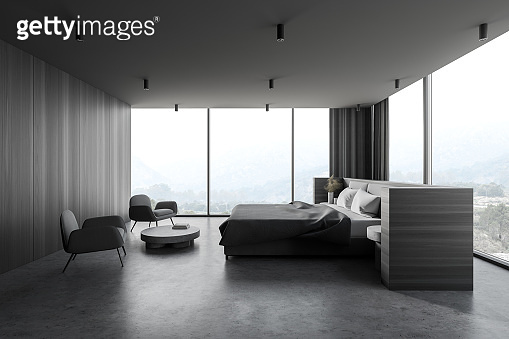 Modern panoramic wooden and gray master bedroom corner with armchairs