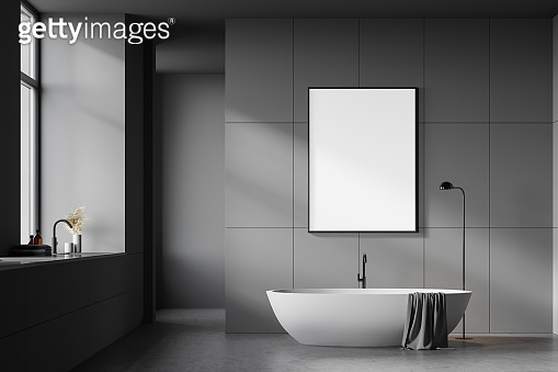 Dark grey bathroom with tub, sink and poster