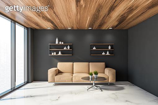 Beige sofa in comfortable grey living room