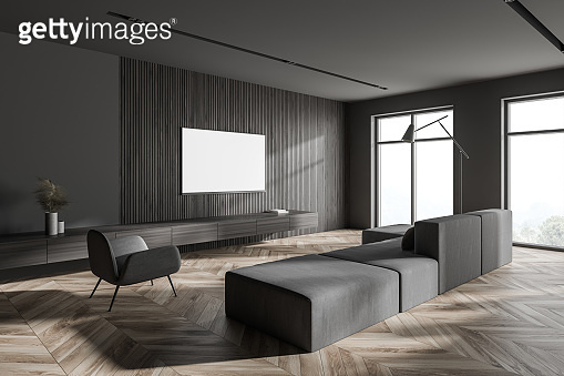 Stylish gray and wooden living room corner with sofa and poster