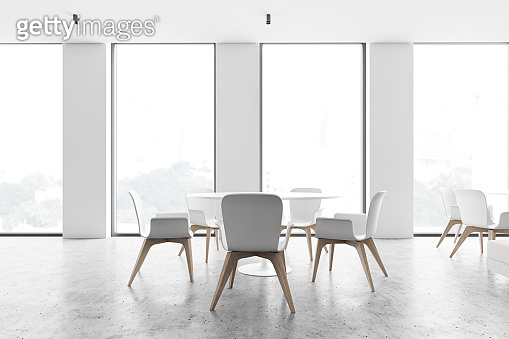 Loft white cafe interior with round tables