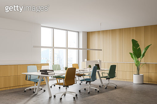 Wooden office corner with colorful chairs