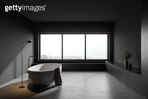 Gray and wooden bathroom with tub and window