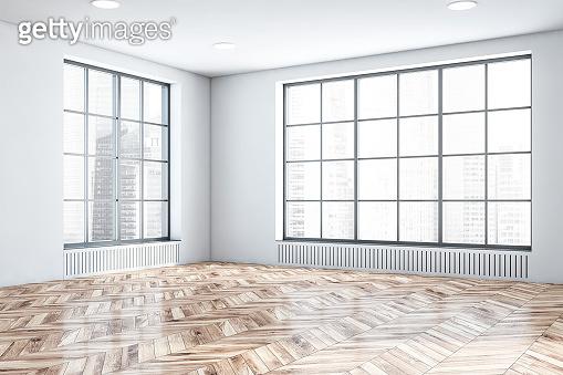 Empty white room corner with windows