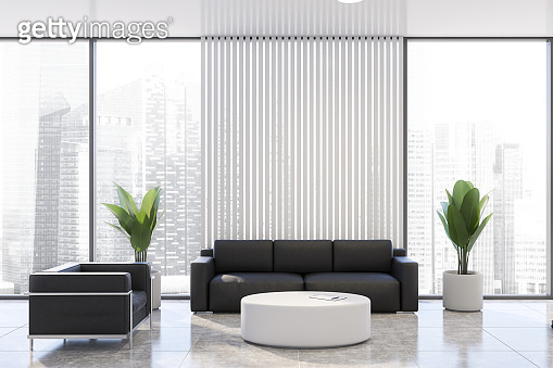 White office waiting room with black sofa