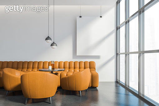 Orange sofa and armchairs in white cafe, poster