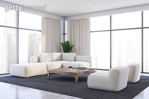 White living room corner, sofa and armchairs