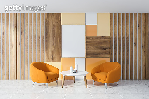 Wooden living room, orange armchairs and poster