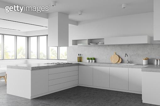 White kitchen corner with countertops