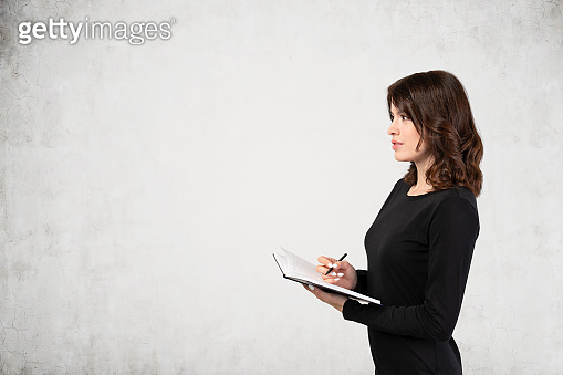 Woman in black dress with notebook, mock up
