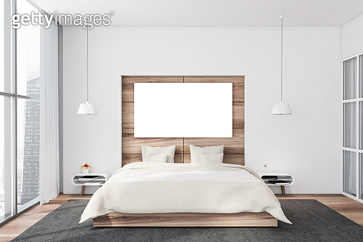 White and wooden bedroom with horizontal poster