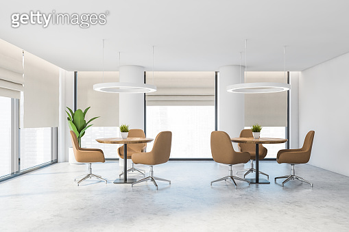 White office lounge area with beige chairs