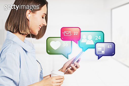 Smiling girl with smartphone, social media icons