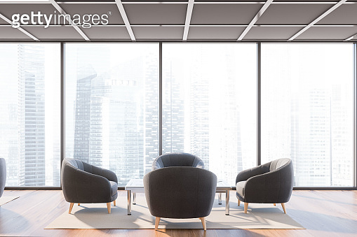 Panoramic office waiting room with gray armchairs
