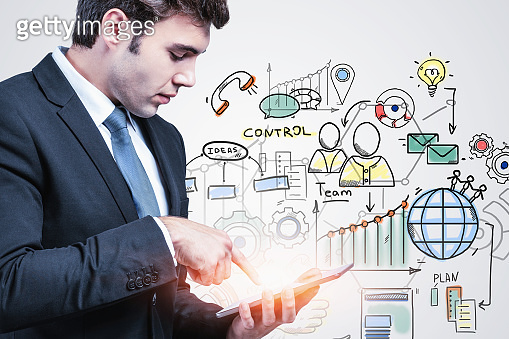 Man with tablet, business plan