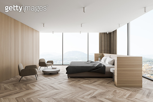 Modern panoramic wooden master bedroom interior with armchairs, side view
