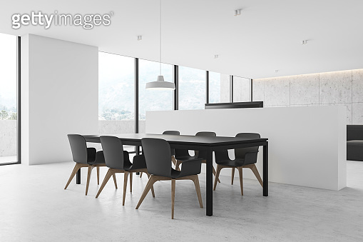 Stylish white dining room corner with gray table